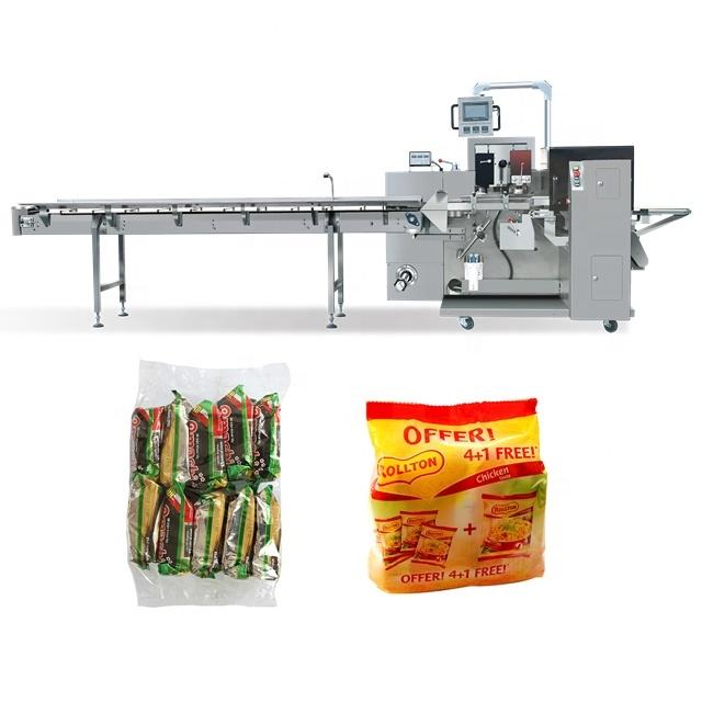 Máy đóng gói bánh là thiết bị làm tăng sự thẩm mỹ, chất lượng, an toàn vệ sinh thực phẩm,... cho người tiêu dùng. Thiết bị có thể đóng gói nhiều kiểu bánh khác nhau bánh cốm, socola, mỳ gói, snack,.... nó là thiết bị đáng cho bạn đầu tư và sử dụng. Là loại máy chuyên dùng trong công nghiệp đóng gói. Bánh được tạo ra vớ nhiều hình dạng, kích thước, đảm bảo mang đến sản phẩm tốt nhất đến tay người tiêu dùng. Có rất nhiều loại máy khác nhau hiện nay với các cách đón gói cũng khác nhau. Nhưng kết quả cuối cùng cũng là tạo ra sản phẩm chất lượng cho khách hàng. Vậy có bao nhiêu cách đóng gói bánh? Nếu bạn còn tò mò về thiết bị, hãy cũng theo chân Máy đóng gói An Thành tìm hiểu các chiếc máy đóng gói có điểm gì khác nhau nhé! Máy đóng gói bánh nằm ngang: Sản phẩm sau khi hoàn thành các khâu sản xuất, sẽ theo dòng chảy trên băng chuyền đi đến khâu cuối cùng để được đóng gói, sắp xếp và vận chuyển đến cho khách hàng Đối với máy đóng gói bánh nằm ngang này còn có thể đóng gói nhiều sản phẩm khác: mỳ gói, bánh cốm, socola, khoai tây chiên, bánh quy,.... Chỉ cần thay đổi linh kiện, phương thức điều khiển, vận hành,... sẽ cho bạn chiếc máy khác để đóng gói Những đặc điểm chính: Điều khiển ba động cơ servo Giao diện trực điện, chương trình PLC thông minh cho bạn có thể dễ dàng vận hành Lưu giữ dữ liệu đóng gói 10 sản phẩm trên màn hình cảm ứng. Giá đỡ phim với thiết bị định tâm tự động Túi có thể điều chỉnh trước đây Máy hàn cuối loại Box Motion với niêm phong kín Nạp phim dưới cùng Cấu trúc hình thành máy đóng gói bánh nằm ngang: 1. Conveyor: Băng tải 2. Adjustable bag former: Túi có thể điều chỉnh trước đây 3. Safety cover: Nắp an toàn 4. Touch screen: Màn hình cảm ứng 5. Film holder: Giá đỡ phim 6. Center sealer: Máy đóng dấu trung tâm 7. End sealer: Máy đóng dấu cuối 8. Discharge machine: Máy xả Máy đóng gói bánh - Sản phẩm được bảo quản và mẫu mã đa dạng hơn Thông số kỹ thuật về máy: Tình trạng: Mới Loại bao bì: Túi, Phim, Giấy bạc Vật liệu đóng gói: Nhựa, giấy Lớp tự động: