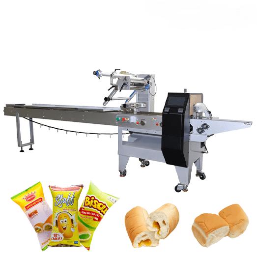 Bánh mì ngọt là thức ăn vặt, nhanh vì có thời gian tiêu thụ ngắn, dễ bị oxi hóa dẫn đến hư hỏng. Bánh mì ngọt thường có thời gian sản xuất và sử dụng trong vòng 3 – 5 ngày, do vậy nếu giai đoạn đóng gói xảy ra bất kỳ lỗi nào cũng có thể ảnh hưởng đến chất lượng bánh trước khi đến tay người tiêu dùng. Máy đóng gói bánh mì ngọt là sản phẩm máy đóng gói thổi khí nito, chuyên dùng để đóng gói các loại bim bim, snack, bánh mì tươi,… để giữ được trọn vẹn hương vị bên trong túi sản phẩm. Máy đóng gói bánh mì ngọt không quá phức tạp khi dễ vận hành, nguyên liệu sau khi được đưa vào túi được mở sẵn, máy sẽ bơm thêm khí vào trong túi bánh mì và dán kín mép túi để không cho không khí vào trong. Việc bơm khí vào trong túi cũng tương tự như việc hút chân không khi bảo quản, thực phẩm sẽ tránh được sự oxi hóa nhằm tăng thời gian bảo quản và giữ nguyên được mùi vị và độ tươi ngon. Thành phẩm sau đó sẽ được in date và chuyển đến các đại lý bán hàng. Máy đóng gói bánh mì ngọt nằm nhỏ: Được thiết kế với dạng nằm ngang nên thiết bị có thể đóng gói nhiều sản phẩm khác nhau như khẩu trang, găng tay, các dạng bánh với các loại bánh có nhiều kích thước khác nhau, các ốc vít,... Các tính năng tiêu chuẩn có trong thiết bị : Được tích hợp 3 độc lập động cơ (Băng Tải, trung tâm niêm phong và kết thúc niêm phong) để quá trình đóng gói được hoàn thành. Điều khiển chuyển động cho phản ứng nhanh chóng để lệnh khác nhau. Định vị chính xác vị trí của các điểm đen để có thể cắt chính xác. Kỹ thuật số nhiệt độ điều khiển các bước, niêm phong chính xác. Cấp thực phẩm có cấu trúc bằng inox SUS304 khôgn gỉ để đảm bảo được sự vệ sinh trong và sau khi đóng gói để đưa đến tay khách hàng. Màn hình cảm ứng màu, hiển thị các chức năng và quá trình đóng gói cho ta có thể quan sát được các quá trình đóng gói. Hướng dẫn sử dụng thân thiện và dễ dàng hoạt động, mọi người có thể vận hành một cách thuận tiện. Được cài đặt thông minh nên khi đóng gói nếu túi không mở hoặc hết túi thì sẽ không chiết rót sản phẩm, trá